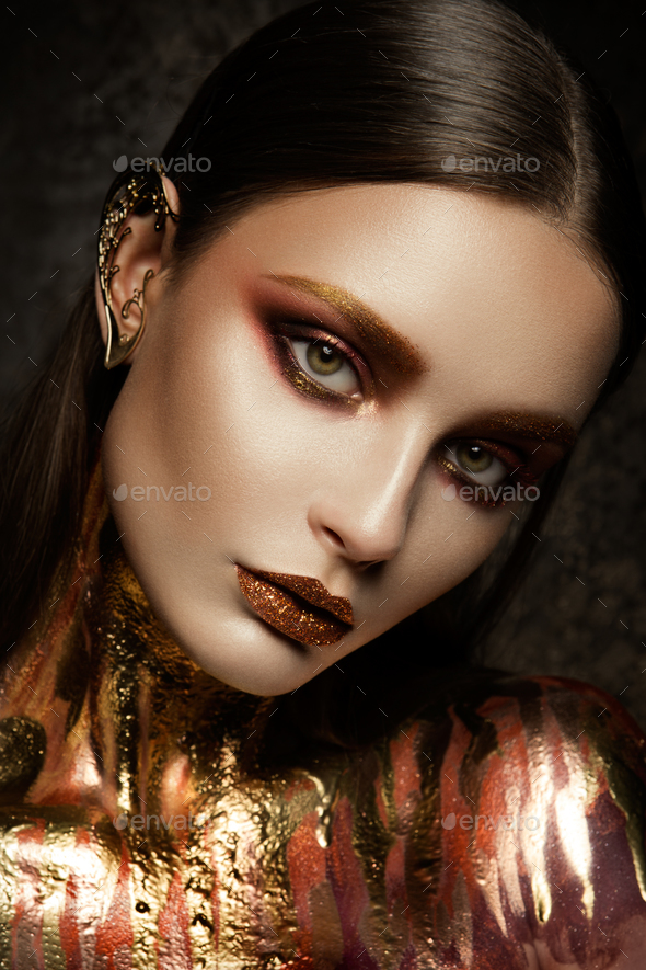 Gold Woman skin. - Stock Photo - Images