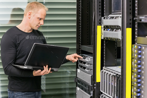 It consultant working with servers - Stock Photo - Images