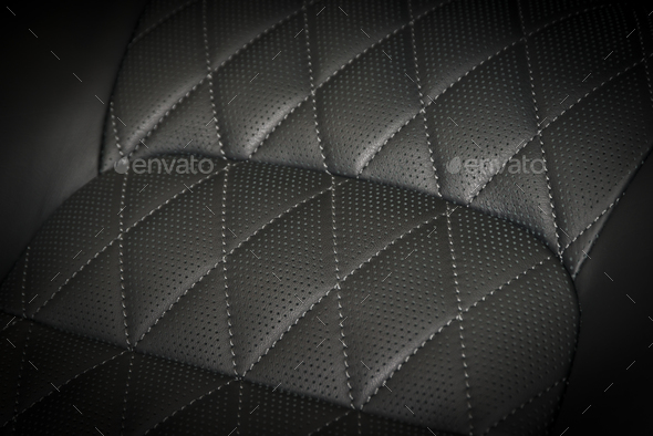 Part of black perforated stitched leather - Stock Photo - Images