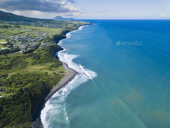 Aerial view of Black Rocks Beach on St Kitts with the island of - Stock Photo - Images