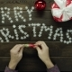 Man Unwraps Candy, Eats It and Throws Wrapper on Xmas Decorated Table, Top Down Shot - VideoHive Item for Sale