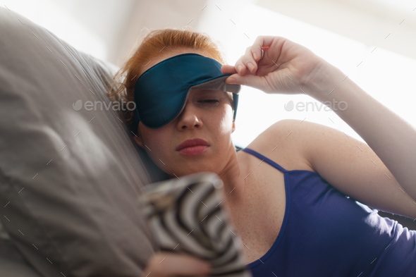 Woman In Bed Waking Up Snoozing Alarm Clock Mobile Phone - Stock Photo - Images