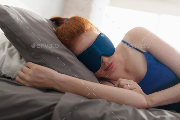 Woman In Bed Sleeping With Sleep Mask On Eyes - Stock Photo - Images