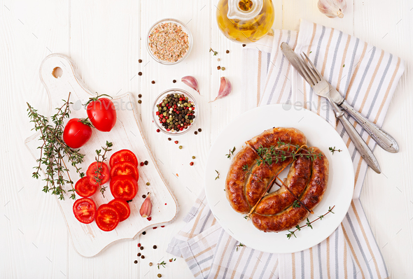 Baked homemade sausage on a white plate. Thanksgiving Day. Top view - Stock Photo - Images