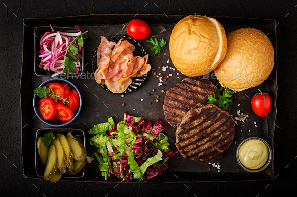 Big sandwich - hamburger burger with beef,  tomato, pickled cucumber  - Stock Photo - Images