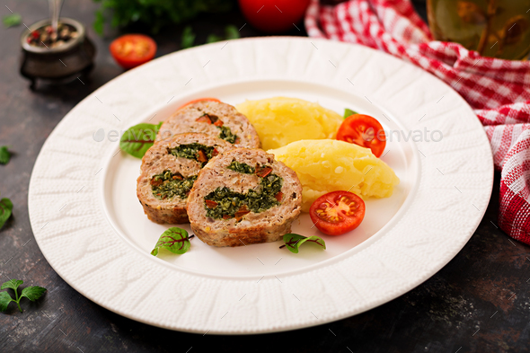Roll of turkey minced meat with spinach and red sweet pepper with garnish of mashed potatoes - Stock Photo - Images