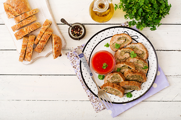 Roll of chicken minced meat with broccoli and tomato sauce. Flat lay. Top view - Stock Photo - Images