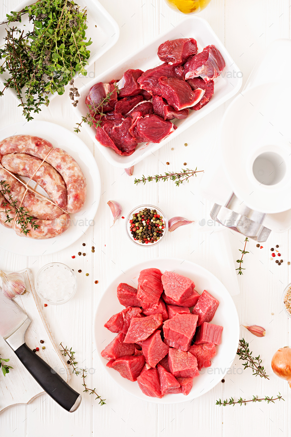 The process of preparing forcemeat by means of a meat grinder.  - Stock Photo - Images