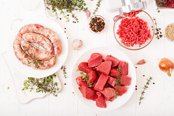 Chopped raw meat. The process of preparing forcemeat by means of a meat grinder.  - Stock Photo - Images