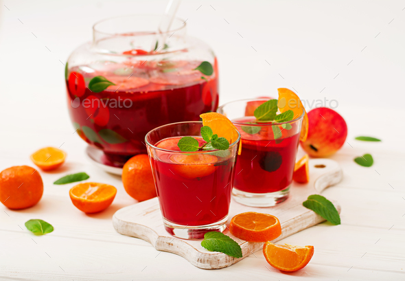 Sangria with fruits and mint on a white background - Stock Photo - Images