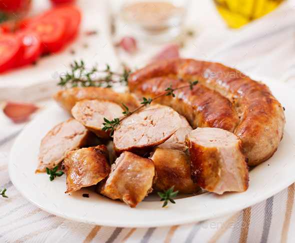 Baked homemade sausage on a white plate. Thanksgiving Day. - Stock Photo - Images