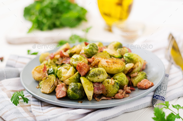Brussels sprouts. Roasted Brussels sprouts with bacon. Delicious lunch. - Stock Photo - Images