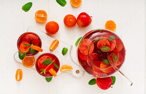 Sangria with fruits and mint on a white background. Top view - Stock Photo - Images