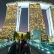 People Walk Along the Bridge To Marina Bay Sands at Night in Singapore. August 2017 - VideoHive Item for Sale