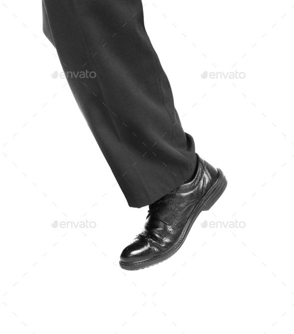 Feet of man in black shoes - Stock Photo - Images