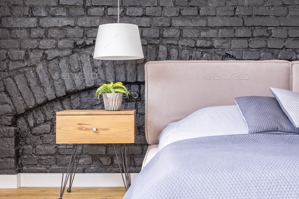 Bedroom with wooden bedside cabinet - Stock Photo - Images