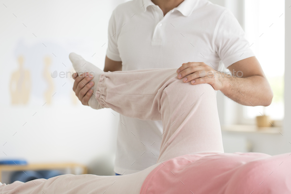 Easing pain in knee area - Stock Photo - Images