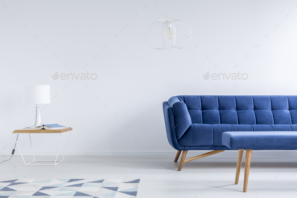 Room with navy blue couch - Stock Photo - Images