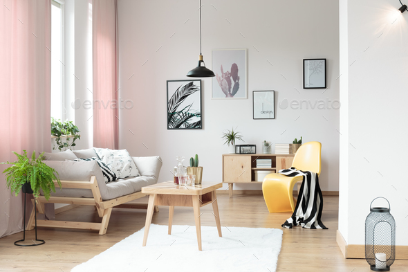Pastel curtains in living room - Stock Photo - Images