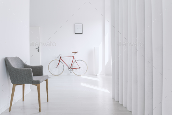 Red bike next to entrance - Stock Photo - Images