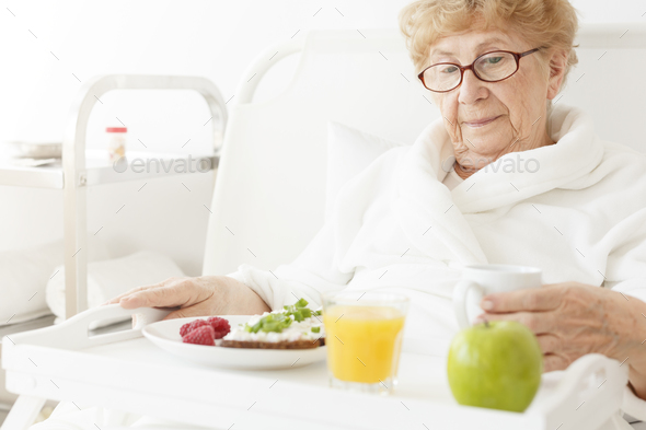 Elder eating meal at hospital - Stock Photo - Images