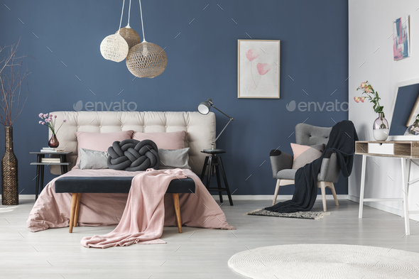 Black blanket on grey armchair - Stock Photo - Images