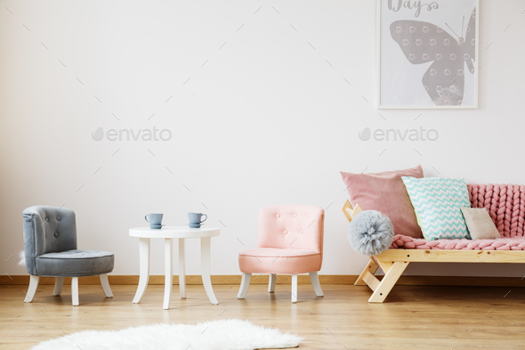 Grey poster above sofa - Stock Photo - Images