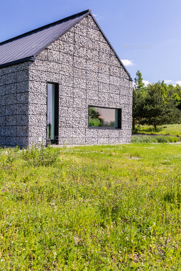 Modern house in the meadow - Stock Photo - Images