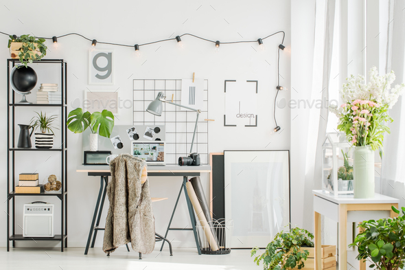 Contemporary home office with flowers - Stock Photo - Images