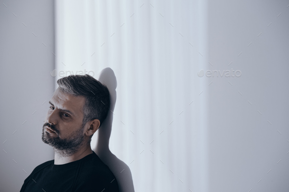 Unhappy man alone at home - Stock Photo - Images