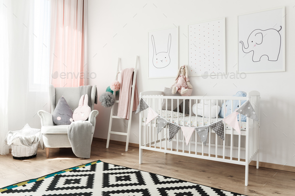 Scandi child's room with armchair - Stock Photo - Images