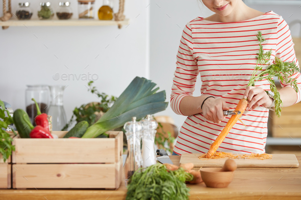 Peeling carrot close-up - Stock Photo - Images