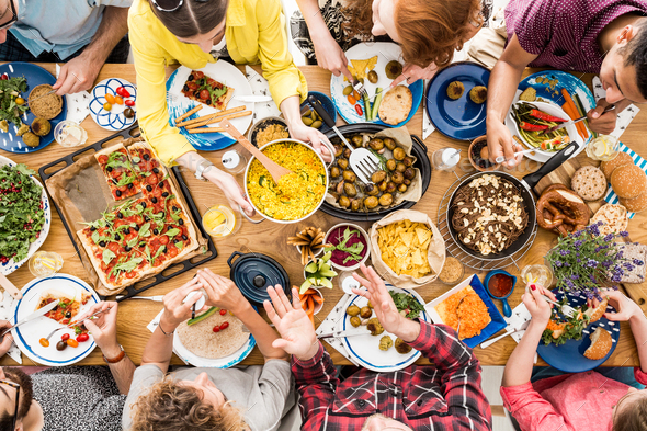 People talk and eat together - Stock Photo - Images