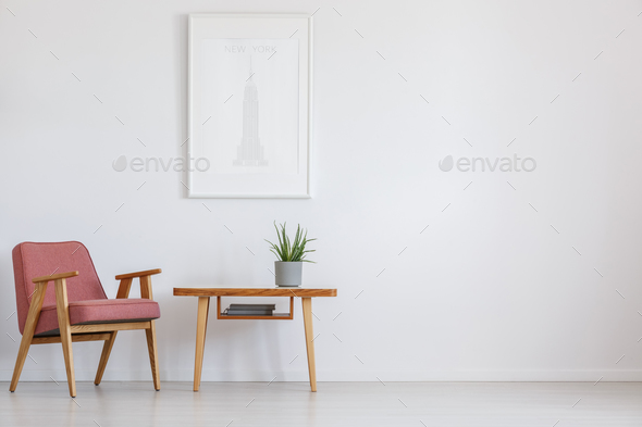 Pink chair next to table - Stock Photo - Images