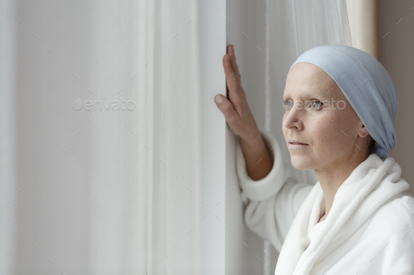 Struggling with cancer alone - Stock Photo - Images