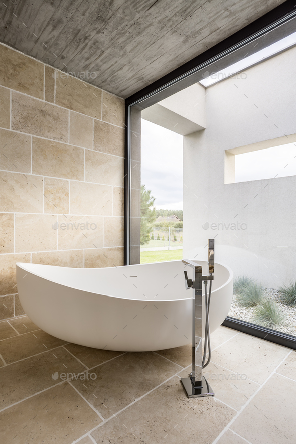 Large bathtub and window wall - Stock Photo - Images