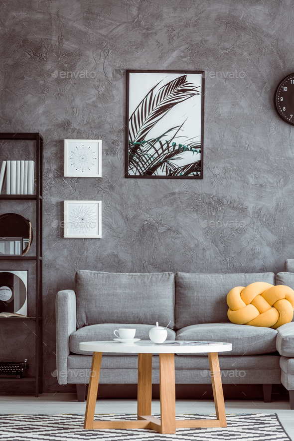 Painting above grey settee - Stock Photo - Images