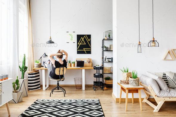 Freelancer in cozy white office - Stock Photo - Images