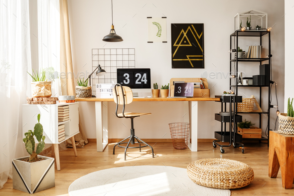 Stylish home office with pouf - Stock Photo - Images