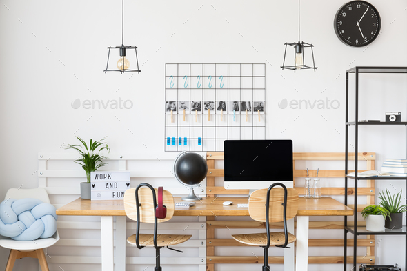 Black clock in white office - Stock Photo - Images