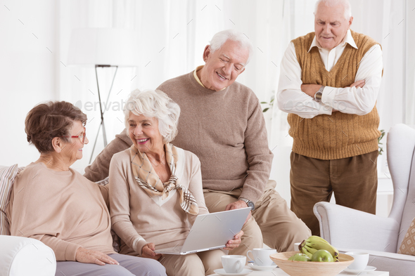 Elder woman uses laptop - Stock Photo - Images
