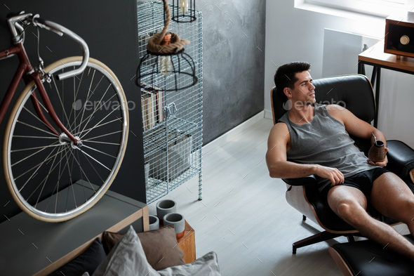 Man relaxes on leather chair - Stock Photo - Images