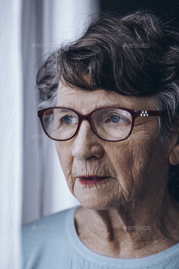 Lonely elderly woman with glasses - Stock Photo - Images