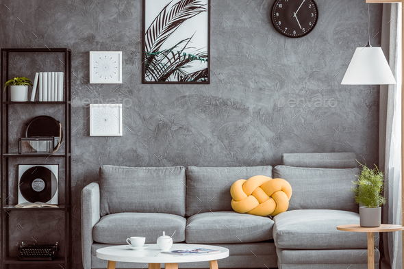 Yellow pillow on grey settee - Stock Photo - Images
