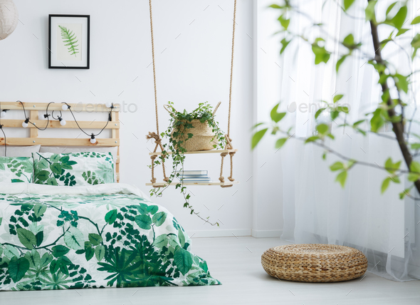 Bright bedroom with leaves motif - Stock Photo - Images