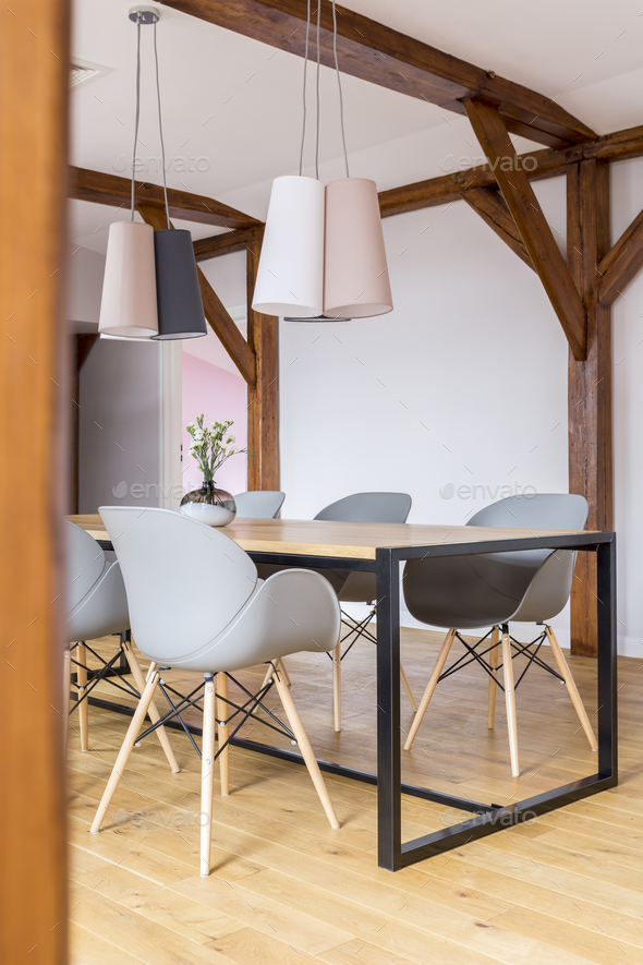 Dining table with grey chairs - Stock Photo - Images