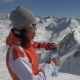 Woman in Ski Suit Opens a Bottle of Clear Pure Water and Drinks - VideoHive Item for Sale