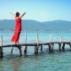 Beautiful Woman Walking Down Pier in Long Red Dress Phu Quoc Island The Woman Costs on a Pier with - VideoHive Item for Sale