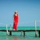 Beautiful Woman Walking Down Pier in Long Red Dress Phu Quoc Island - VideoHive Item for Sale