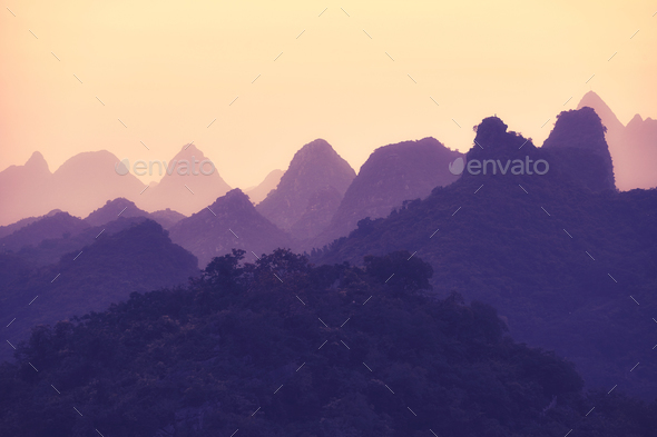 Scenic sunset over Karst mountains formations in Guilin, China. - Stock Photo - Images